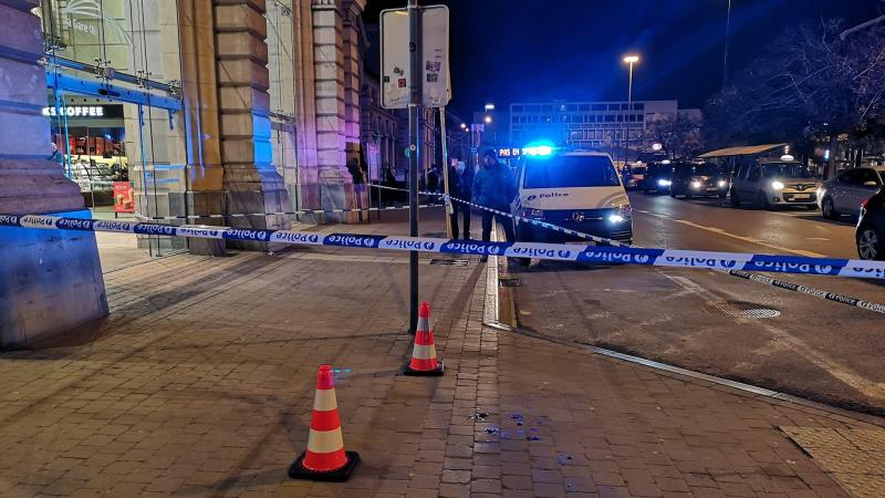Police tape surrounds blood stains
