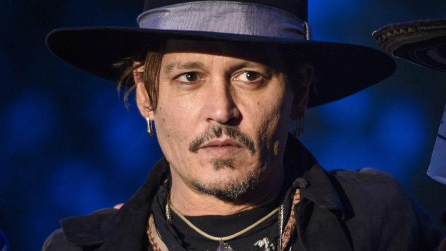 Le photographe de la tournée de Johnny Depp explique l'apparence du chanteur