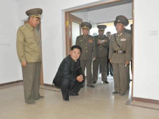 090ab3bb533e0 PsBattle Kim Jong Un squatting infront of officers - Imgur